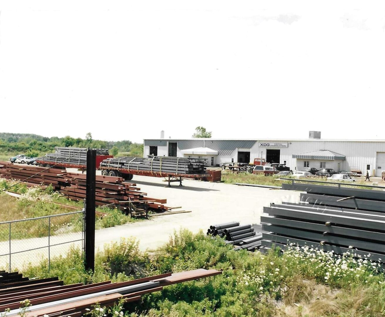 A facility with stacks of steel outside